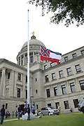 The Mississippi State Flag with the Confederate emblem is decommissioned outside the State Capitol. The Mississippi Color Guard  folded the flags from the Capitol and presented them to Philip Gunn speaker of the house and Delbert Hosemann Lt. Governor and Katie Blount Director MSDAH MS Dept of Archived and History. They then drove the flags to the 2 Mississippi Museums and gave them to Judge Ruben Anderson President of the  MS Dept. of Archives and History board , who then gave the to Pamela Junior- Director of the 2 MS Museums. The Museum will build an exhibit for the 3 flags that flew over the Capitol.After 126 years the State flag with the Confederate emblem is finally down and progress had been made in Mississippi.Jackson, Mississippi, U.S., July 1, 2020.  REUTERS/Suzi Altman