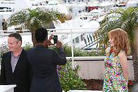 Chris Rock takes a photo of himself, Jessica Chastain looks on at the Madagascar 3: Europe's Most Wanted photocall at the 65th Cannes Film Festival. Friday 18th May 2012 in Cannes Film Festival, France.