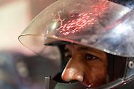 Un motociclista mira un espectáculo pirotécnico de la Feria Internacional de la Pirotecnia 2020.  /  A motor cyclist stares at a pyrotechnic show.