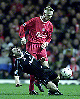 Liverpool v Crystal Palace (FA Cup 4th rd replay) 5/02/03<br />Liverpool's Sami Hypia brings down Palace's Dougie Freedman<br />photo: Aidan Ellis.