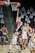 Stanford Cardinal guard Noah Taitz (20) scores over Southern California Trojans guard Amar Ross (55) during an NCAA men's basketball game, Wednesday, March 3, 2021, in Los Angeles. USC defeated Stanford 79-42. (Jon Endow/Image of Sport)