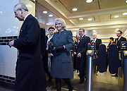 © Licensed to London News Pictures. 30/01/2013. London, UK Their Royal Highnesses enter Farringdon Station through a ticket barrier.  Kings Cross St Pancras station. HRH The Prince of Wales and HRH The Duchess of Cornwall visit Farringdon Station in London today 30th January 2013. They were carrying out engagements to celebrate London Underground's 150th anniversary.]. Photo credit : Stephen Simpson/LNP