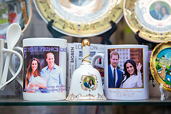 © Licensed to London News Pictures. 16/05/2018. Windsor, UK. Mugs celebrating the birth of Prince George and the engagement of Prince Harry and Meghan Markle on display in a shop window in Windsor. Prince Harry and Meghan Markle are to be married on Saturday in Windsor. Photo credit: Rob Pinney/LNP