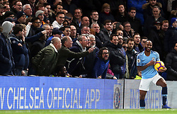 Manchester City's Raheem Sterling collects the ball from in front of the fans