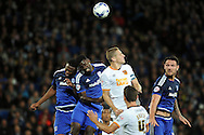 Hull's Michael Dawson (white shirt) beats Cardiff City's Bruno Ecuele Manga and Kagisho Dikgacoi. Skybet football league championship match, Cardiff city v Hull city at the Cardiff city stadium in Cardiff, South Wales on Tuesday 15th Sept 2015.<br /> pic by Carl Robertson, Andrew Orchard sports photography.