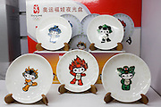 2008 Olympic Games official Fuwa mascot character plates in souvenir shop, Wangfujing Street, Beijing, China