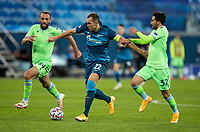 SAINT PETERSBURG, RUSSIA - NOVEMBER 04: Artem Dzyuba of Zenit St Petersburg is chased down by Cedat Muriqi and Danilo Cataldi of SS Lazio during the UEFA Champions League Group F stage match between Zenit St. Petersburg and SS Lazio at Gazprom Arena on November 4, 2020 in Saint Petersburg, Russia. (Photo by MB Media)