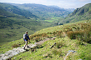 © Licensed to London News Pictures. 17/05/2014. Capel Curig, UK. A man walks up the PYG track. Walkers climb Snowdon in warm sunshine in North Wales today 17th May 2014. Photo credit : Stephen Simpson/LNP