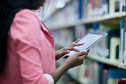 Female student using digital tablet in library (Credit Image: © Image Source/Albert Van Rosendaa/Image Source/ZUMAPRESS.com)