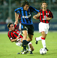 Ancona 12/08/2003<br />Trofeo Tim - Tim Cup <br />Christian Vieri (Inter) challenged by Cristian Brocchi (Left) and Andrea Pirlo (right Milan)