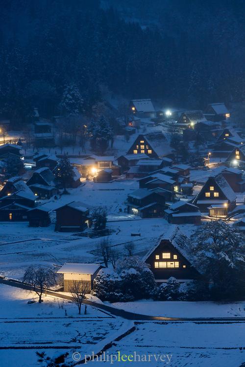 Illuminated village during winter at night, Shirakawa-go, Japan