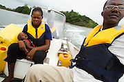 Community Health Nurse Isatu Djalloh carries two-year-old Blackie on her lap as he's transported aboard an emergency speedboat from the village of Yoni, on Sherbro Island, to the district hospital in Bonthe, Sierra Leone on Thursday April 22, 2010. Suffering from severe dehydration, the boy needed to be referred to the district hospital.