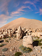 Statue head of from left, Apollo, Herekles & Eagle in front of the 62 BC Royal Tomb of King Antiochus I Theos of Commagene, west Terrace, Mount Nemrut or Nemrud Dagi summit, near Adıyaman, Turkey .<br /> <br /> If you prefer to buy from our ALAMY PHOTO LIBRARY  Collection visit : https://www.alamy.com/portfolio/paul-williams-funkystock/nemrutdagiancientstatues-turkey.html<br /> <br /> Visit our CLASSICAL WORLD HISTORIC SITES PHOTO COLLECTIONS for more photos to download or buy as wall art prints https://funkystock.photoshelter.com/gallery-collection/Classical-Era-Historic-Sites-Archaeological-Sites-Pictures-Images/C0000g4bSGiDL9rw