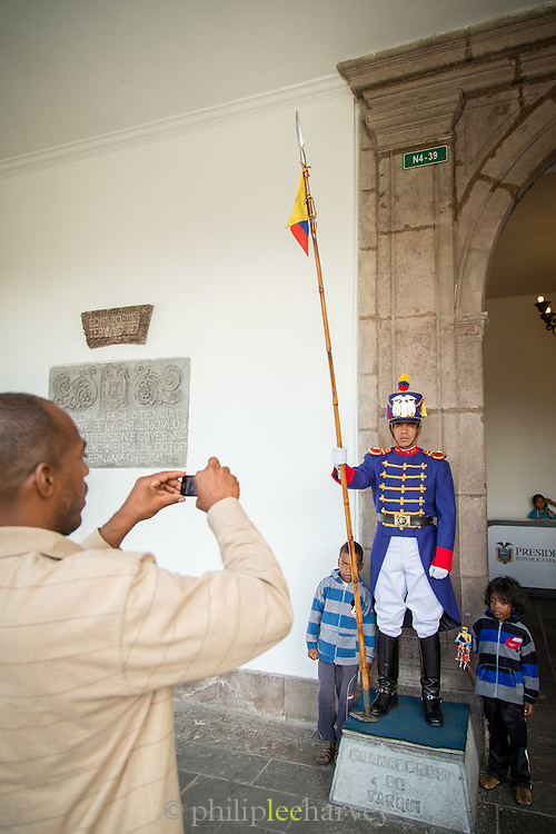 Tourists and a guard at The Presidential Palace, Independence Square, Quito, Ecuador, South America