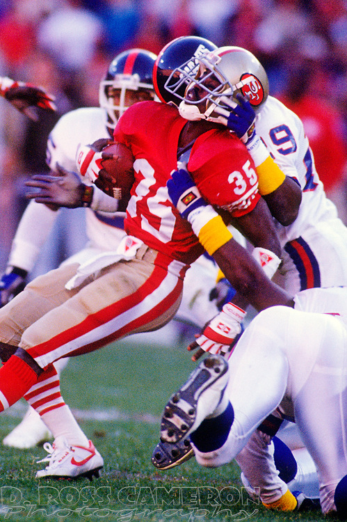 San Francisco 49ers kickoff return man Dexter Carter (35) is brought down by New York Giants special teams man Myron Guyton (29) in the fourth quarter of their NFC championship football game, Sunday, Jan. 20, 1991 at Candlestick Park in San Francisco. The Giants won, 15-13 and now move on to the Super Bowl against the Buffalo Bills. (Photo by D. Ross Cameron)