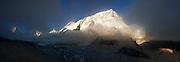 Sunset on Nuptse (7861m), as seen looking over the Khumbu glacier along the trail to Everest Base Camp between Lobuche and Gorak Shep, Khumbu region, Sagarmatha National Park, Himalaya Mountains, Nepal.