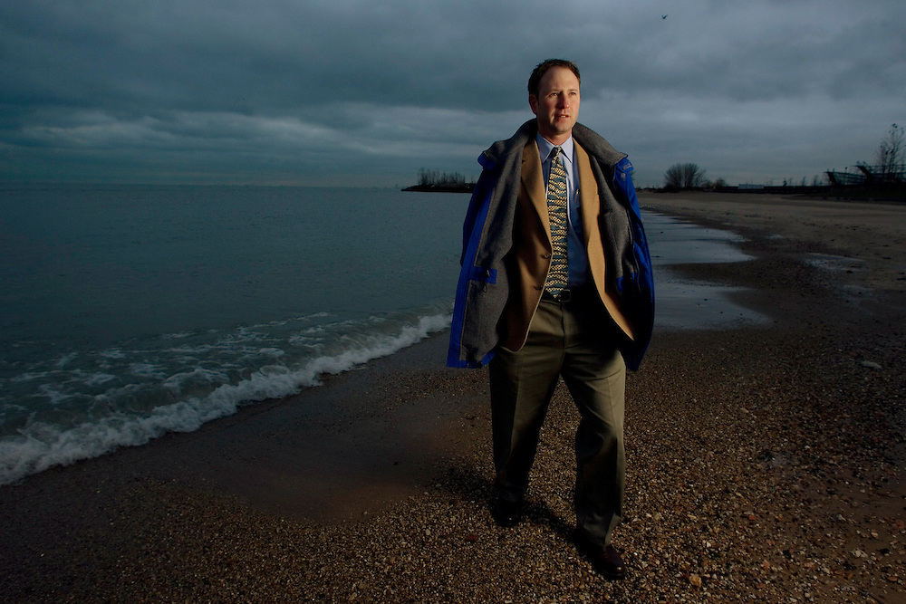 Cameron Davis, President and CEO of the Alliance for the Great Lakes, photographed on the Lake Michigan shore in Chicago.