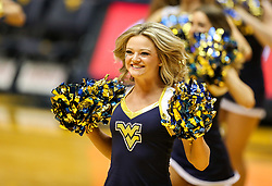Feb 10, 2018; Morgantown, WV, USA; A West Virginia Mountaineers dance team member performs during the first half at WVU Coliseum. Mandatory Credit: Ben Queen-USA TODAY Sports