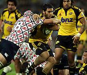 Piri Weepu tackled by Ben Mowen<br />Super 14 rugby union match, Waratahs vs Hurricanes, Sydney, Australia. <br />Saturday 14 May 2010. Photo: Paul Seiser/PHOTOSPORT