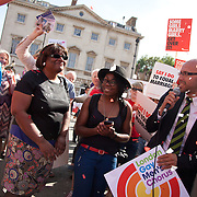 Diane Abbott, Labour MP greets the celebrating crowd. The Same Sex Marriage bill had been passed in the House of Lords. London Gay Chorus and supporters of the bill celebrate outside the House of Lords. The campaign for the bill has lasted decades. Summary of the Marriage (Same Sex Couples) Bill 2012-13 to 2013-14<br /> A Bill to make provision for the marriage of same sex couples in England and Wales, about gender change by married persons and civil partners, about consular functions in relation to marriage, for the marriage of armed forces personnel overseas, and for connected purposes.