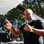 Tens of thousands took to the streets in Central London taking part in the the Global Climate Strike, September 20th 2019, London, United Kingdom.  Asad Rehman from War on Want adresses the crowd. The day of strike for the climate was a global event with millions taking part across the globe. The strike was inspired by Greta Thunberg, a Swedish school girl who started the first school strike for the climate. Her action inspired school children across the world to go on strike demanding radical climate change policies to save their future. On September 20th adults aand children alike went out on strike to demand radical political change and climate justice. The day included speeches and a march through central London.