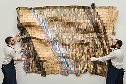 "© Licensed to London News Pictures. 29/03/2019. LONDON, UK. Technicians present ""Zebra Crossing 2"", 2007, by El Anatsui (Est. GBP 550,000-750,000). Preview of Sotheby's upcoming Modern and Contemporary African Art sale.  Works from artists across the African diaspora will be offered for sale on 2 April.  Photo credit: Stephen Chung/LNP"