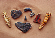 Ancestral Puebloan artifacts including corn cobs, broken arrowhead and potsherds at Goat Riding a Bicycle Ruins, Grand Gulch, Bears Ears National Monument, Utah.
