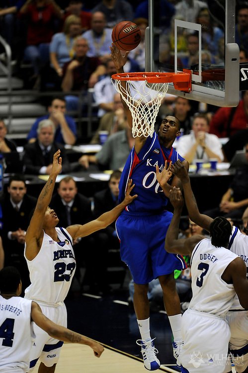 7 APR 2008: Darrell Arthur (00) of the University of Kansas dunks over Derrick Rose  (23) of the University of Memphis during final game of the 2008 NCAA Final Four Division I Men's Basketball championships held at the Alamodome in San Antonio, TX.  Kansas defeated Memphis 75-68 to win the national title.  © Brett Wilhelm