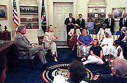 US President Bill Clinton and First Lady Hillary Clinton during the weekly radio address on Social Security in the Oval Office of the White House July 29, 1995 in Washington, DC.