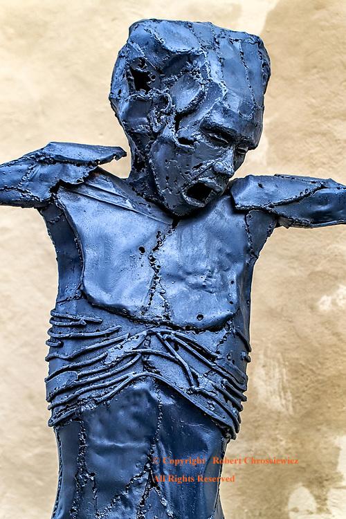 Blue Anguish: A metallic statue, expressing the distressing anguish of men, Havana Cuba.
