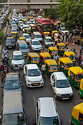 Gridlocked traffic in New Delhi, India. Delhi's infrastructure consistently struggles to cope with the rapid expansion of private vehicles and the challenge of pollution.