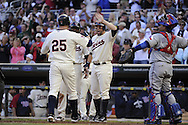MINNEAPOLIS - SEPTEMBER 04:  Jim Thome #25 is greeted by Michael Cuddyer #5 of the Minnesota Twins after Thome hit his second home run of the game and 584th in his career, putting him ahead of Mark McGwire into 9th place all-time in the fourth inning against the Texas Rangers on September 4, 2010 at Target Field in Minneapolis, Minnesota.  The Twins defeated the Rangers 12-4.  (Photo by Ron Vesely)