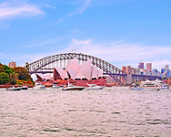 What could be more iconic when you think of Australia than a view of the Sydney harbour overlooking the opera house framed by the world famous bridge. <br /> <br /> I spent a great amount of time picking the light and location but this fantastic result made it all worth it in the end. This image shows us the bridge and opera house in fantastic detail. I love the strong colours from the reds of the opera hose to the soft blues in the buildings behind. The soft colours really make this a great image to look at and enjoy.<br /> <br /> This image is ready to download for personal or commercial use and to order as a limited edition print. I will only make available 50 prints of this image, you can choose to have it printed on canvas or as a framed or unframed print ensuring you have an exclusive peace of highly collectable photo art to add to any home or business.
