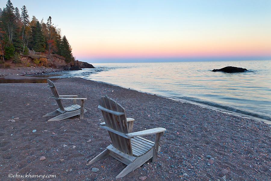 Adirondack chairs on the shores of Lake superior at Lutsen Resort, Minnesota, USA