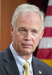 July 27, 2017 - Washington, District of Columbia, United States of America - United States Senator Ron Johnson (Republican of Wisconsin), one of several key Republican Senators, answers a reporter's question as he announces he will not support the ''skinny repeal'' of the Affordable Care Act (ACA) unless they have assurances from US House leaders that the bill will never become law.  Instead they demand negotiations or they will kill the bill, in the US Capitol in Washington, DC on Thursday, July 27, 2017.  .Credit: Ron Sachs / CNP (Credit Image: © Ron Sachs/CNP via ZUMA Wire)