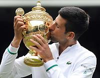 Lawn Tennis - 2021 All England Championships - Men's Final Sunday - Wimbledon - Novak Djokovic  v Matteo Berrettini on Centre Court<br /> <br /> Novak Djokovic kisses the Mens singles trophy<br /> <br /> Credit : COLORSPORT / Andrew Cowie