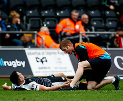 Owen Watkin of Ospreys receives ,medical attention<br /> <br /> Photographer Simon King/Replay Images<br /> <br /> Guinness PRO14 Round 18 - Ospreys v Dragons - Saturday 23rd March 2019 - Liberty Stadium - Swansea<br /> <br /> World Copyright © Replay Images . All rights reserved. info@replayimages.co.uk - http://replayimages.co.uk