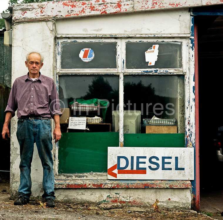 An elderly male mechanic at Yarcombe Coach House and Garage on the 19th July 2008 in Yarcombe in the United Kingdom.