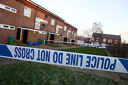 © licensed to London News Pictures. Rochdale, UK  04/02/2012. Police guard a taped off area around Lower Bamford Close after the body of a man was discovered in a house, yesterday afternoon. Two men have been arrested on suspicion of murder. Photo credit should read Joel Goodman/LNP