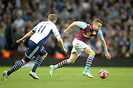 Tom Cleverley of Aston Villa bursting past Chris Brunt of West Bromwich Albion. The FA cup, 6th round match, Aston Villa v West Bromwich Albion at Villa Park in Birmingham, Midlands on Saturday 7th March 2015<br /> pic by John Patrick Fletcher, Andrew Orchard sports photography.