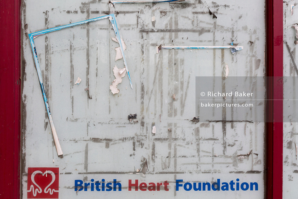The marks left by posters and flyers are left on a window of a British Heart Foundation retailer in Dartford, on 3rd October 2019, in Dartford, Kent, England. Voters in Dartford voted 64% in favour of Brexit during the 2016 referendum.
