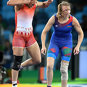 Tunisia wrestler Marwa Armi jumped in celebration after winning the bronze medal in the women's freestyle 58kg final against Yuliya Ratkevich of Azerbaijan on Thursday during the 2016 Summer Olympics Games in Rio de Janeiro, Brazil.