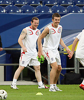 Photo: Chris Ratcliffe.<br />England Training Session. FIFA World Cup 2006. 30/06/2006.<br />Wayne Rooney and Michael Carrick in training.