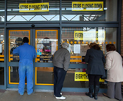 © Licensed to London News Pictures. 18/12/12. Coventry, UK. The Comet store closes in Coventry. Pictured, Last minuet bargain hunters wait for the shop to open for the last time. Photo credit : Dave Warren/LNP