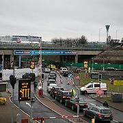 Police diverting traffic. Three Rising Up! activists have blockaded the main access road into Heathrow Terminals 1, 2 and 3, by chaining themselves to a vehicle in protest against the proposed 3rd runway, Februrary 20th, 2017. The activists are protesting against the proposed third runway by the Government, which goes against the needed cuts to CO2 emmissions.