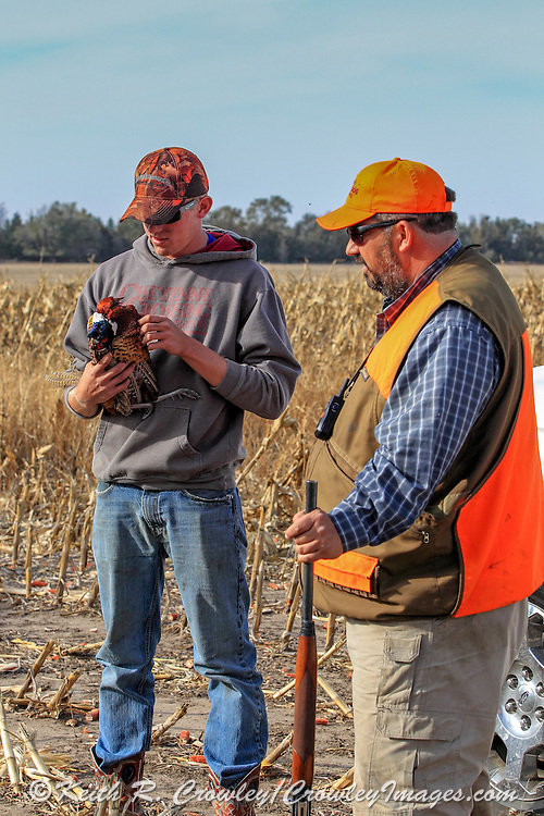 s spend time talking with farmer during a Pheasant hunt in South Dakota