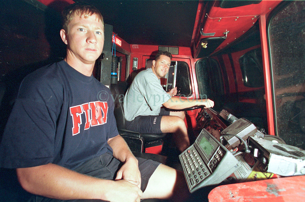 14 September 2001. New York, New York - USA.<br /> Post 9/11 World Trade Center attack.<br /> Exhausted New York firefighters (not ID'd) return to their station after an exhausting shift on site at the remains of the World Trade Center.  <br /> Photo ©; Charlie Varley/varleypix.com