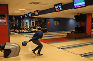 Sedar Ardic bowls with friends (out of frame) at the Kayseri Forum shopping mall, one of many recently built malls in the central Turkish city.