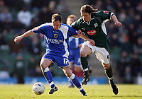 Kevin Cooper for Cardiff holds off the challenge of Lilian Nalis<br /> <br /> Photo: Richard Eaton.<br /> <br /> Plymouth Argyle v Cardiff City. Coca Cola Championship. 18/03/2006.