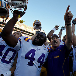 Oct 2, 2010; Baton Rouge, LA, USA; LSU Tigers head coach Les Miles celebrates with players following a win over the Tennessee Volunteers at Tiger Stadium. LSU defeated Tennessee 16-14.  Mandatory Credit: Derick E. Hingle